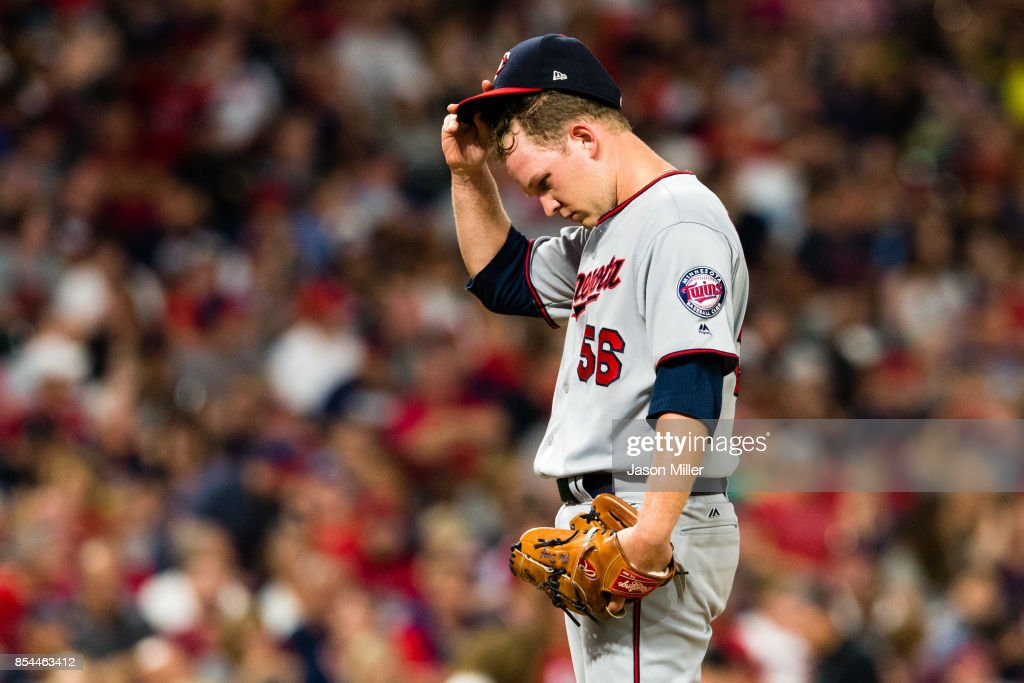 Relief pitcher Tyler Duffey #56 of the Minnesota Twins reacts after giving up a run during the third inning against the Cleveland Indians at Progressive Field on September 26, 2017 in Cleveland, Ohio.
