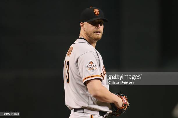 Relief pitcher Will Smith of the San Francisco Giants throws a warm up pitch during the ninth inning of the MLB game against the Arizona Diamondbacks...