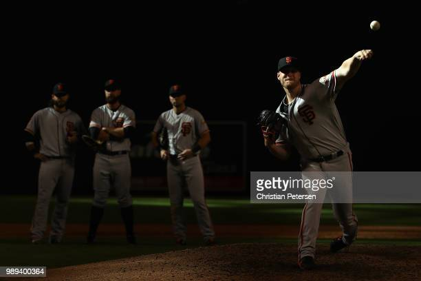 Relief pitcher Will Smith of the San Francisco Giants throws a warmup pitch during the ninth inning of the MLB game against the Arizona Diamondbacks...