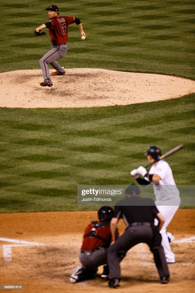 Relief pitcher Yoshihisa Hirano #66 of the Arizona Diamondbacks delivers to home plate during the fourth inning against the Colorado Rockies at Coors Field on July 11, 2018 in Denver, Colorado.