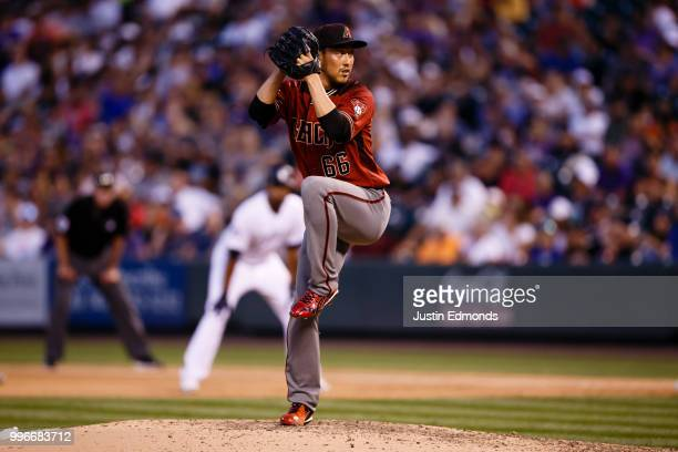 Relief pitcher Yoshihisa Hirano of the Arizona Diamondbacks delivers to home plate during the fourth inning against the Colorado Rockies at Coors...