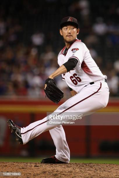Relief pitcher Yoshihisa Hirano of the Arizona Diamondbacks pitches against the Chicago Cubs during the eighth inning of the MLB game at Chase Field...