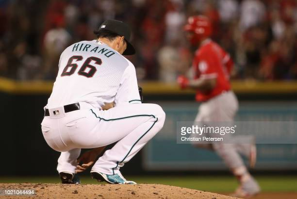 Relief pitcher Yoshihisa Hirano of the Arizona Diamondbacks reacts after giving up a solo home run to Jefry Marte of the Los Angeles Angels during...