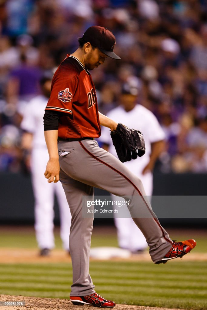 Relief pitcher Yoshihisa Hirano #66 of the Arizona Diamondbacks reacts prior to being taken out of the game during the fourth inning against the Colorado Rockies at Coors Field on July 11, 2018 in Denver, Colorado.