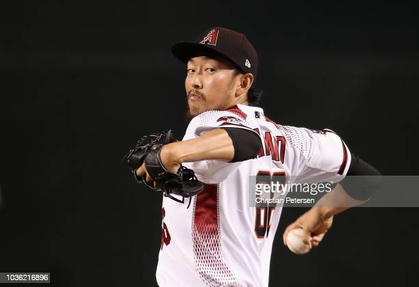Relief pitcher Yoshihisa Hirano of the Arizona Diamondbacks throws a warm up pitch during the eighth inning of the MLB game against the Chicago Cubs...