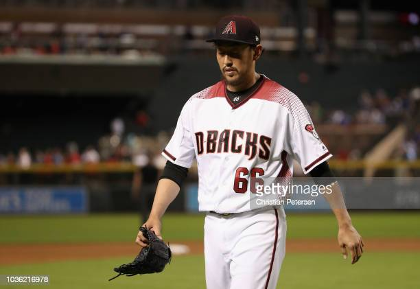 Relief pitcher Yoshihisa Hirano of the Arizona Diamondbacks walks off the mound after pitching against the Chicago Cubs during the eighth inning of...