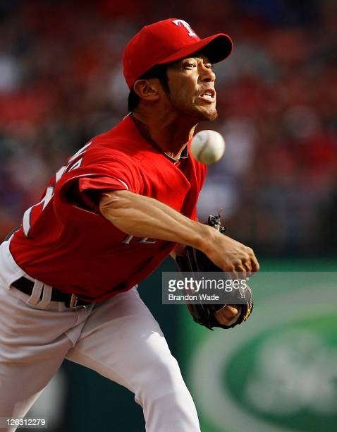 Relief pitcher Yoshinori Tateyama of the Texas Rangers throws a pitch during the sixth inning of a baseball game against the Seattle Mariners at...