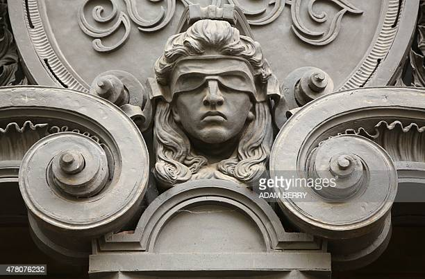 A relief sculpture of the blindfolded allegorical personification of Lady Justice can be seen at the Moabit criminal court near the prison in...