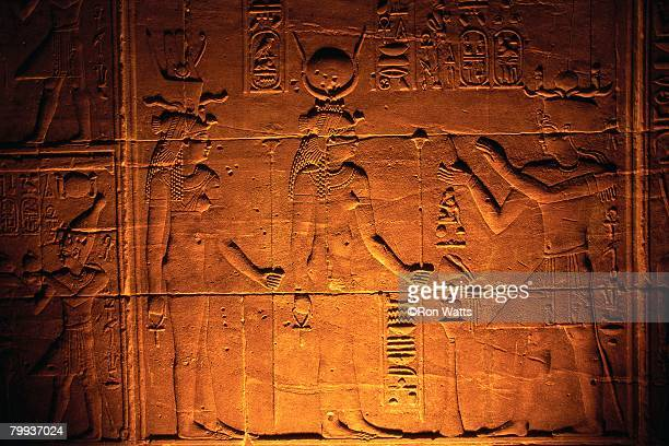 Relief Sculpture on Philae Temple Depicting Hathor and Isis with Worshiper