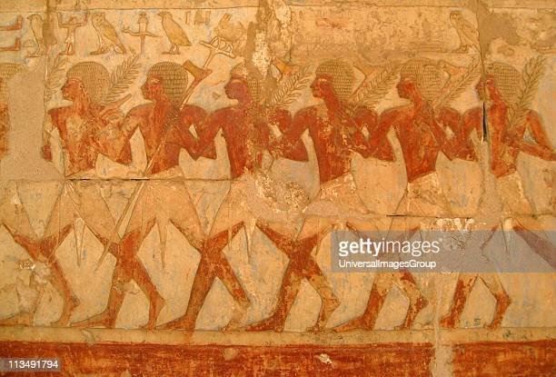 Relief showing members of Queen Hatshepsut's trading expedition to the mysterious 'Land of Punt' from this pharaoh's elegant mortuary temple at Deir...