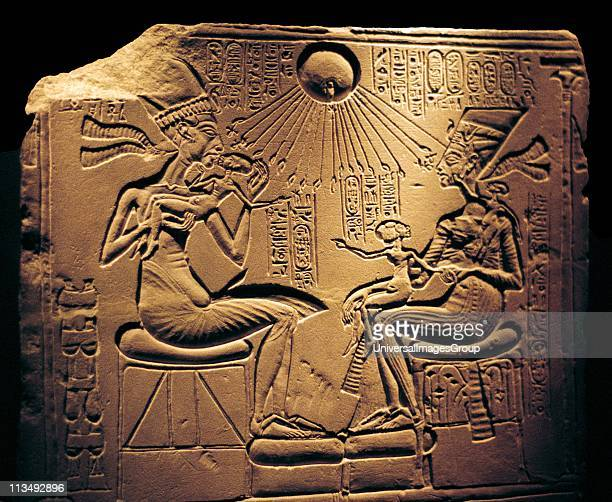 Relief showing Nefertiti Great Royal Wife and the Egyptian Pharaoh Akhenaten and their children with Aten the sun's disc which they worshipped