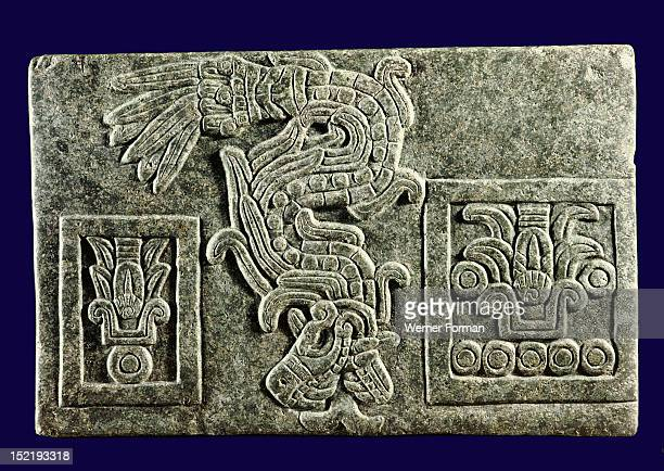 Relief showing the Feathered Serpent major symbol of Quetzalcoatl descending between two symbols of years The dates cover a period of 20 years and...