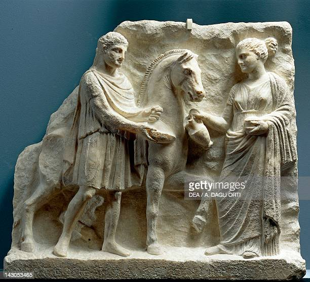 Relief showing the scene of the outdoor libation 330315 BC fragment of a votive stele in marble dedicated to Hephaestion from Pella Greece Greek...