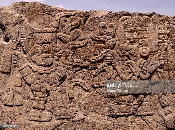 Relief showing Tlaloc the rain god bringing blessings to the maize goddess Each deity holds a maize plant with ripened cobs towards the other Mexico...