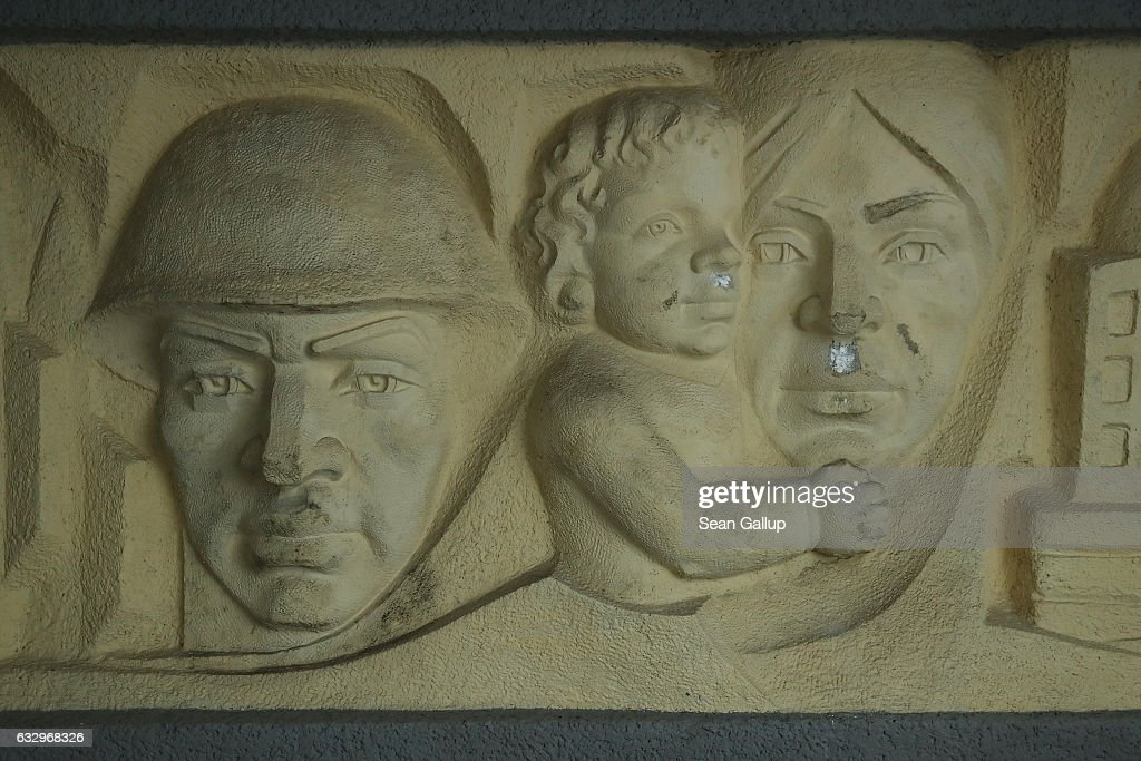 A relief shows a soldier and a mother with a child on a wall in the officers' building at the former Soviet military base on January 26, 2017 in Wuensdorf, Germany. Wuensdorf, once called 'The Forbidden City,' was the biggest base for the Soviet armed forces in communist East Germany from 1945 until the last Soviet troops left in the early 1990s following the end of the Cold War and the reunification of Germany. While Soviet troops pulled out of eastern Europe after 1989, Russian troops have in recent years intervened in Ukraine. The NATO military alliance has strengthened its presence in the Baltic states in an effort to prevent similar Russian intervention there.