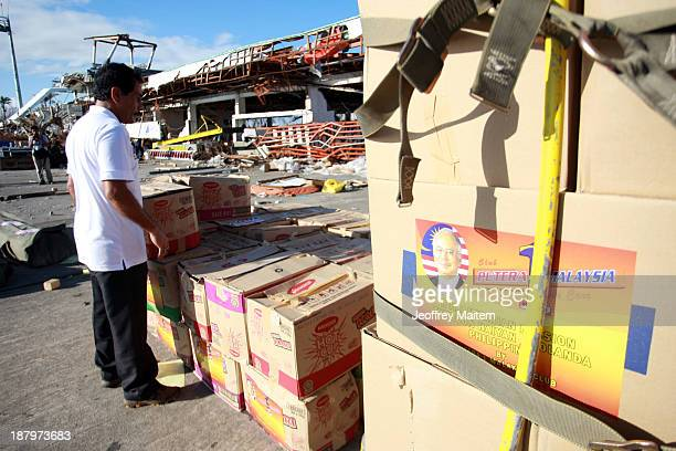 Relief supplies from the Malaysian government arrive at the airport on November 14 2013 in Tacloban Leyte Philippines to help people affected by...