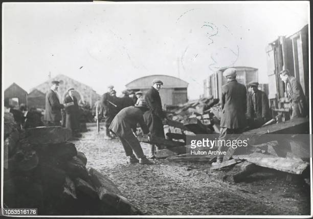 A relief train being unloaded at a railway station in the west of Ireland during a famine February 1925 it consists of old railway sleepers purchased...