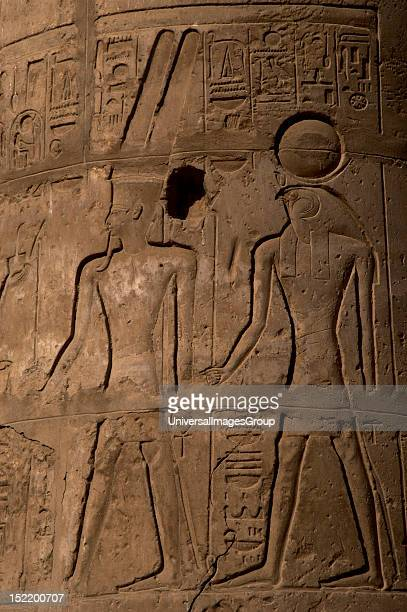 ART Relief with god Amon ' the mysterious' helmet covered with two large feathers and beard Behind him RA higher solar god represented with a...