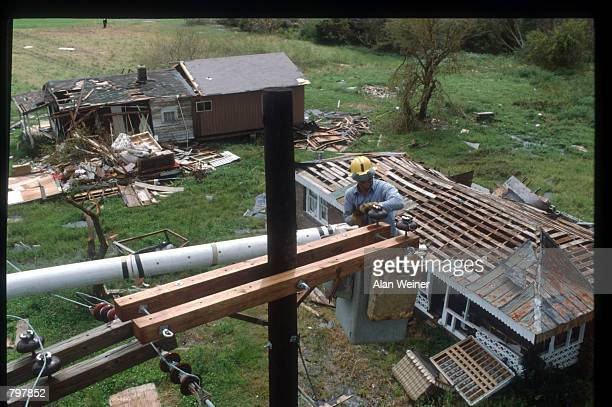 A relief worker repairs a telephone line September 27 1989 in South Carolina Hugo is ranked as the eleventh most intense hurricane to strike the US...