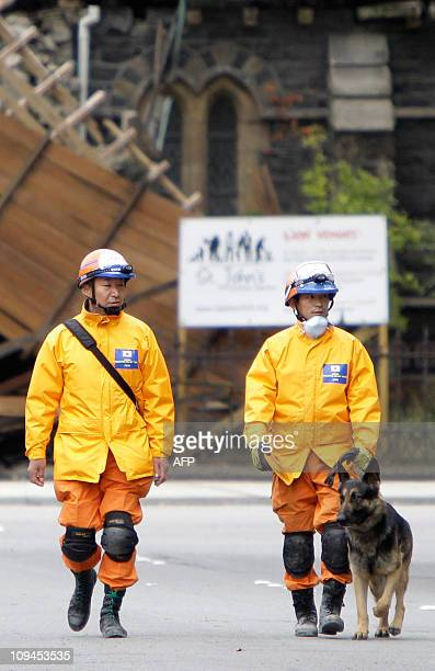 Relief workers from Japan walk though the central earthquake zone in Christchurch on February 26 2011 four days after a eadly earthquake rocked New...