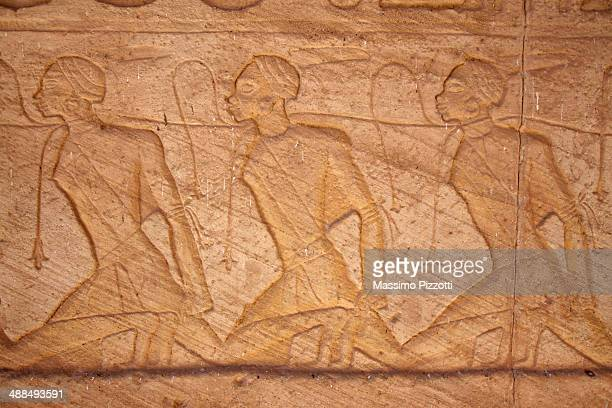 reliefs and hieroglyphics in abu simbel - egyptian slaves stock pictures, royalty-free photos & images