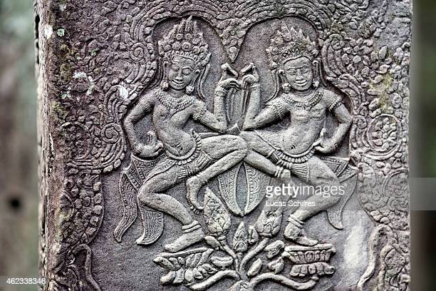 Reliefs show apsaras the divine dancers engraved in Bayon temple on October 9 2009 in Angkor Cambodia The Bayon temple was built in the late 12th...