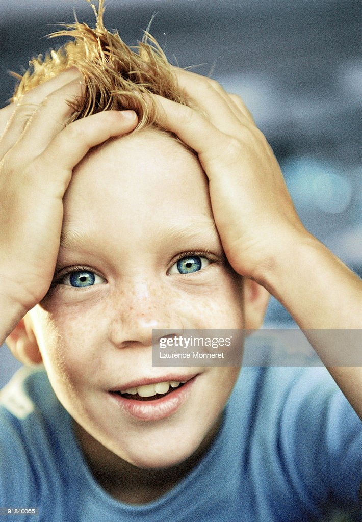 Relieved boy smiling : Stock Photo