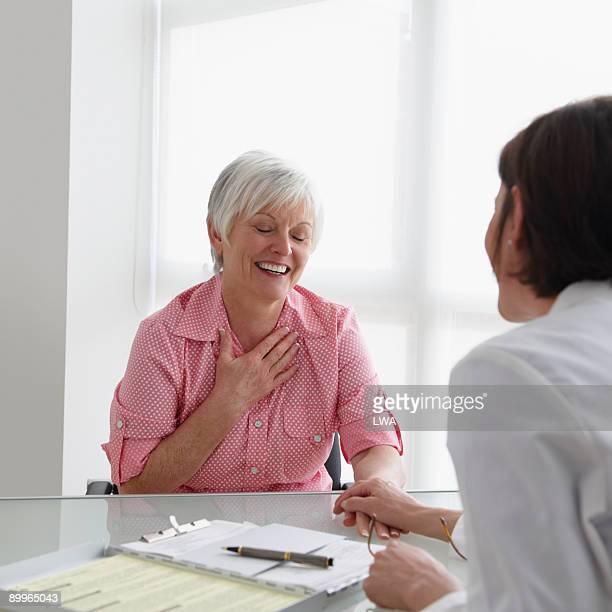 Relieved Patient Speaking To Doctor