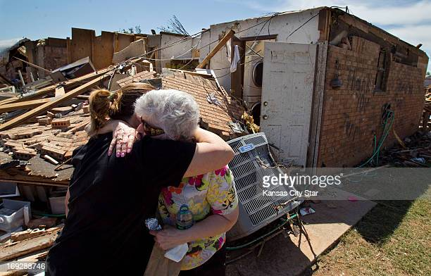Relieved to see her aunt for the first time since the storm Debbie Davis left hugs Linda Woods as residents searched damaged homes in Moore Oklahoma...