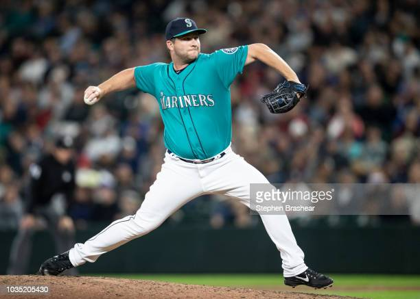 Reliever Adam Warren of the Seattle Mariners delivers a pitch during a game against the New York Yankees at Safeco Field on September 7 2018 in...