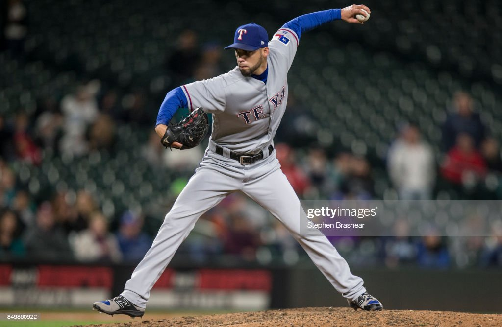 Reliever Alex Claudio #58 of the Texas Rangers delivers a pitch during the ninth inning of a game against the Seattle Mariners at Safeco Field on September 19, 2017 in Seattle, Washington. The Rangers won the game 3-1.