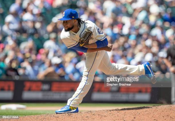 Reliever Alex Colome of the Seattle Mariners delivers a pitch during the eighth inning of a game against the Colorado Rockies at Safeco Field on July...
