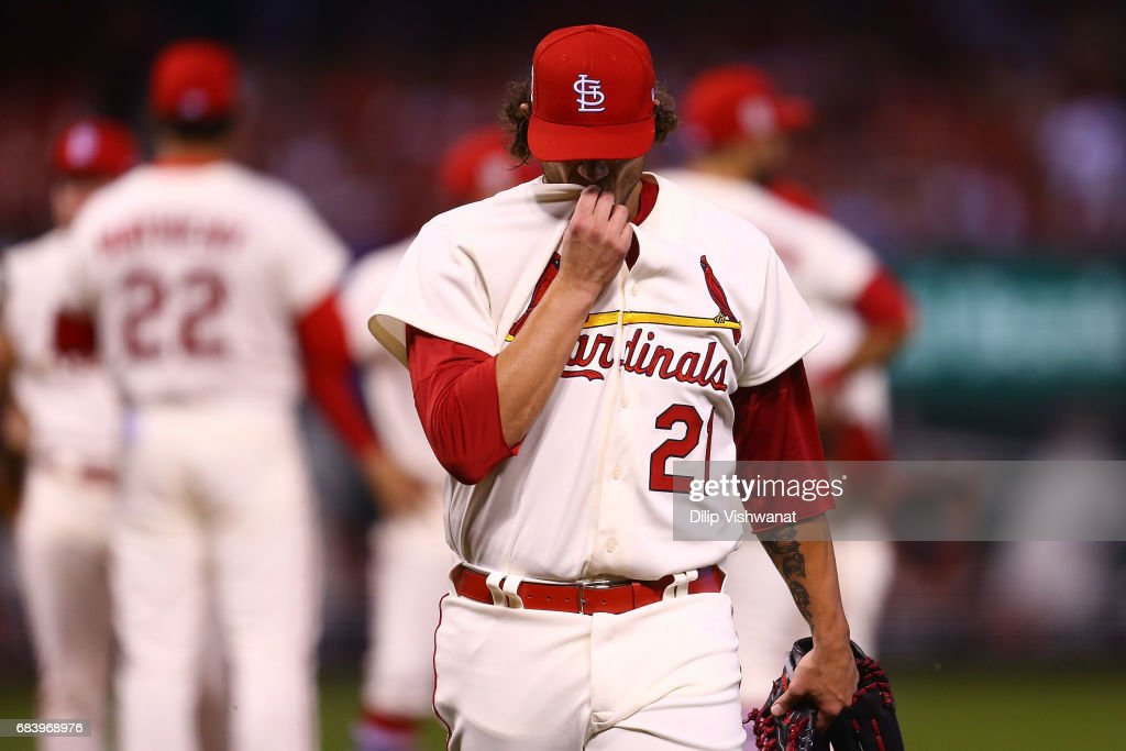 Reliever Brett Cecil #21 of the St. Louis Cardinals returns to the dugout after throwing only nine pitches against the Boston Red Sox in the eighth inning at Busch Stadium on May 16, 2017 in St. Louis, Missouri.