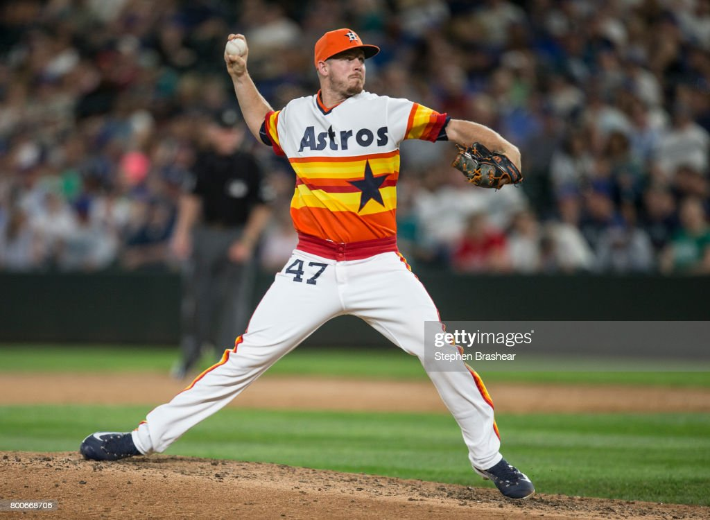 Reliever Chris Devenski #47 of the Houston Astros delivers pitch during the eighth inning of a game against the Seattle Mariners at Safeco Field on June 24, 2017 in Seattle, Washington. The Astros won 5-2.