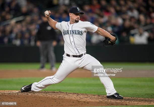 Reliever Dan Altavilla of the Seattle Mariners delivers a pitch during the ninth inning of a game against the Miami Marlins at Safeco Field on April...