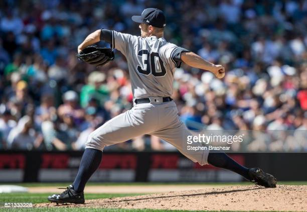 Reliever David Robertson of the New York Yankees delivers a pitch during the eighth inning of a game against the Seattle Mariners at Safeco Field on...