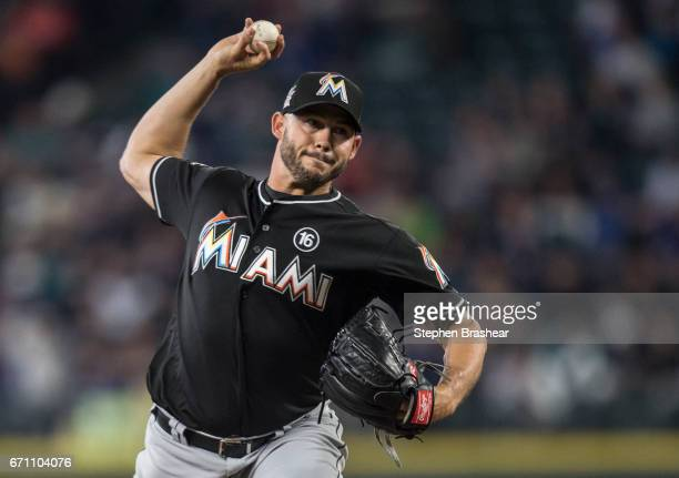 Reliever Dustin McGowan of the Miami Marlins delivers a pitch during a game Seattle Mariners at Safeco Field on April 19 2017 in Seattle Washington...