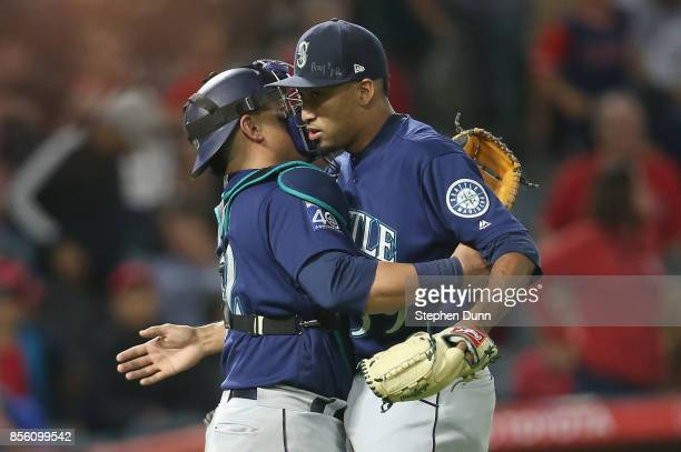 Reliever Edwin Diaz and catcher Carlos Ruiz of the Seattle Mariners celebrate after Diaz pitched the ninth inning to pick up the save against the Los...
