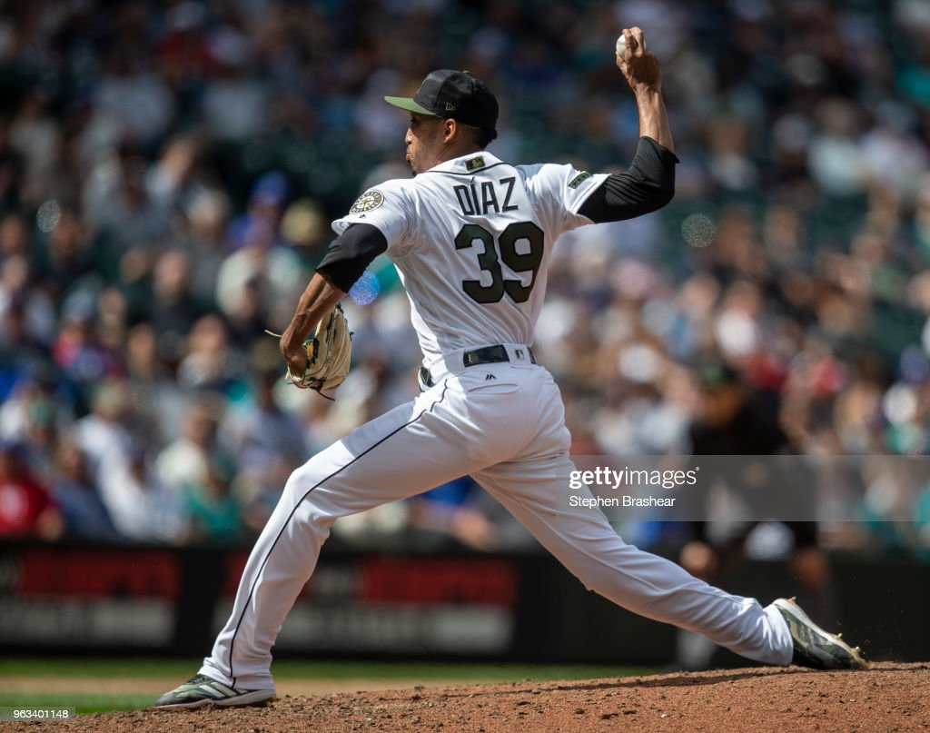 Reliever Edwin Diaz #39 of the Seattle Mariners delivers a pitch during the ninth inning of a game against the Texas Rangers at Safeco Field on May 28, 2018 in Seattle, Washington. The Mariners won the game 2-1. MLB players across the league are wearing special uniforms to commemorate Memorial Day.