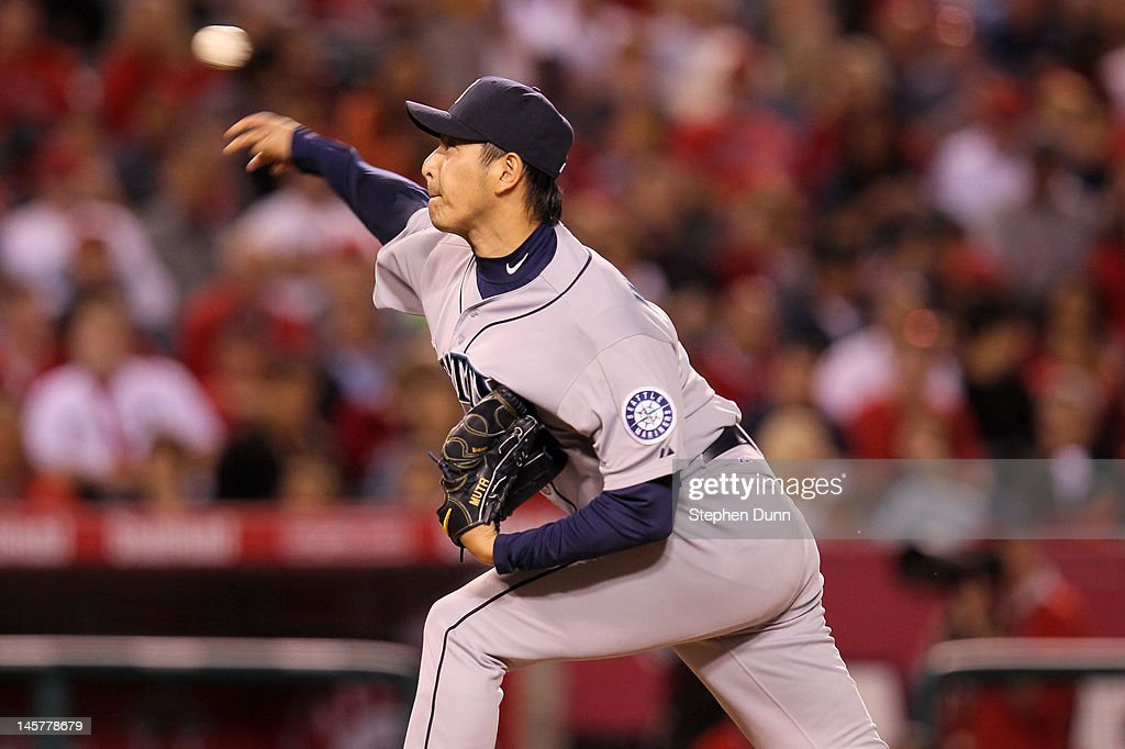 Reliever Hisashi Iwakuma #18 of the Seattle Mariners throws a pitch against the Los Angeles Angels of Anaheim at Angel Stadium of Anaheim on June 5, 2012 in Anaheim, California.