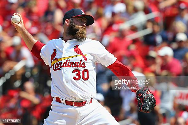 Reliever Jason Motte of the St Louis Cardinals pitches against the Miami Marlins in the eighth inning at Busch Stadium on July 6 2014 in St Louis...