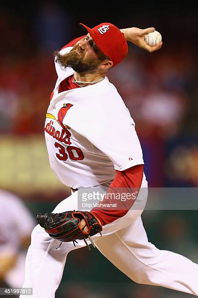 Reliever Jason Motte of the St Louis Cardinals pitches against the Pittsburgh Pirates in the ninth inning at Busch Stadium on July 10 2014 in St...