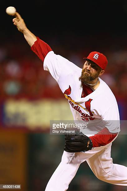 Reliever Jason Motte of the St Louis Cardinals pitches against the Milwaukee Brewers in the eighth inning at Busch Stadium on August 1 2014 in St...