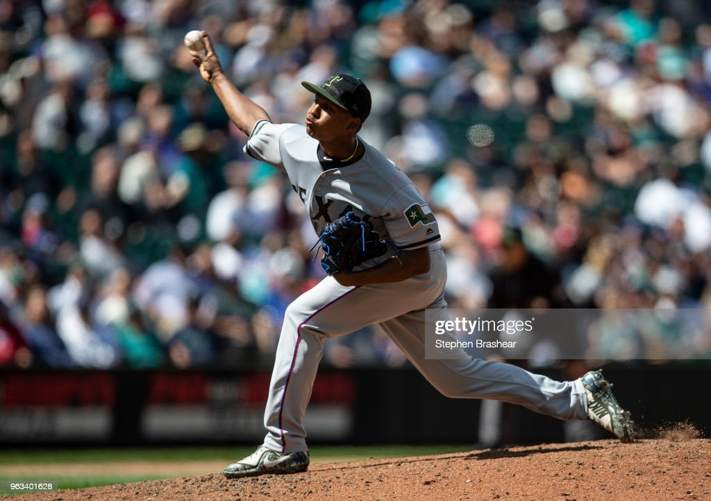 Reliever Jose Leclerc #62 of the Texas Rangers delivers a pitch during the seventh inning of a game against the Seattle Mariners at Safeco Field on May 28, 2018 in Seattle, Washington. The Mariners won the game 2-1. MLB players across the league are wearing special uniforms to commemorate Memorial Day.