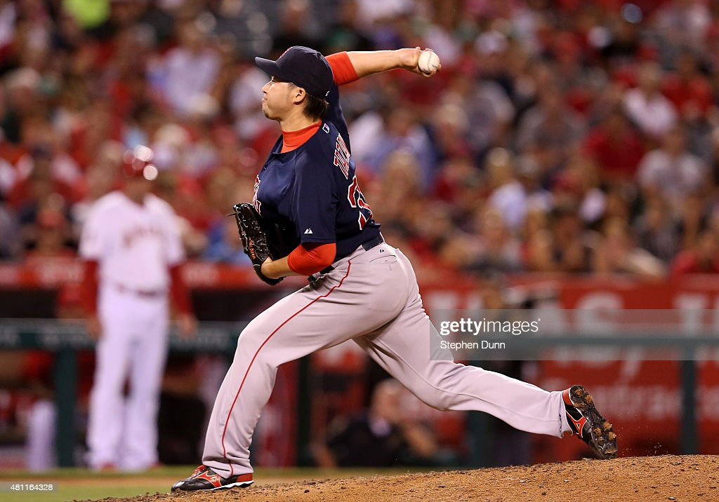 Reliever Junichi Tazawa #36 of the Boston Red Sox throws a pitch in the eighth inning against the Los Angeles Angels of Anaheim at Angel Stadium of Anaheim on July 17, 2015 in Anaheim, California.