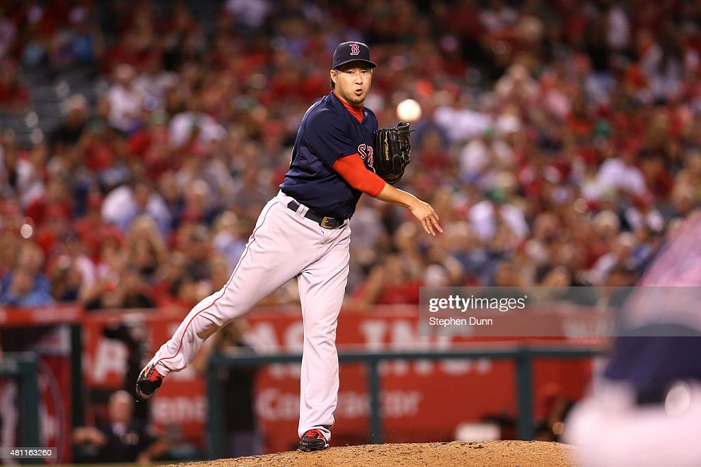 Reliever Junichi Tazawa #36 of the Boston Red Sox throws to first in the eighth inning to try to pick off pinch runnerTaylor Featherston #8 of the Los Angeles Angels of Anaheim at Angel Stadium of Anaheim on July 17, 2015 in Anaheim, California.