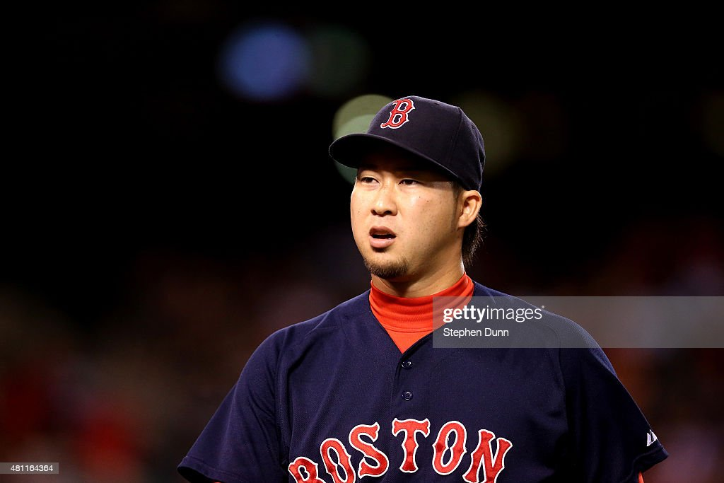Reliever Junichi Tazawa #36 of the Boston Red Sox walks off the field after getting three outs in the eighth inning against the Los Angeles Angels of Anaheim at Angel Stadium of Anaheim on July 17, 2015 in Anaheim, California.