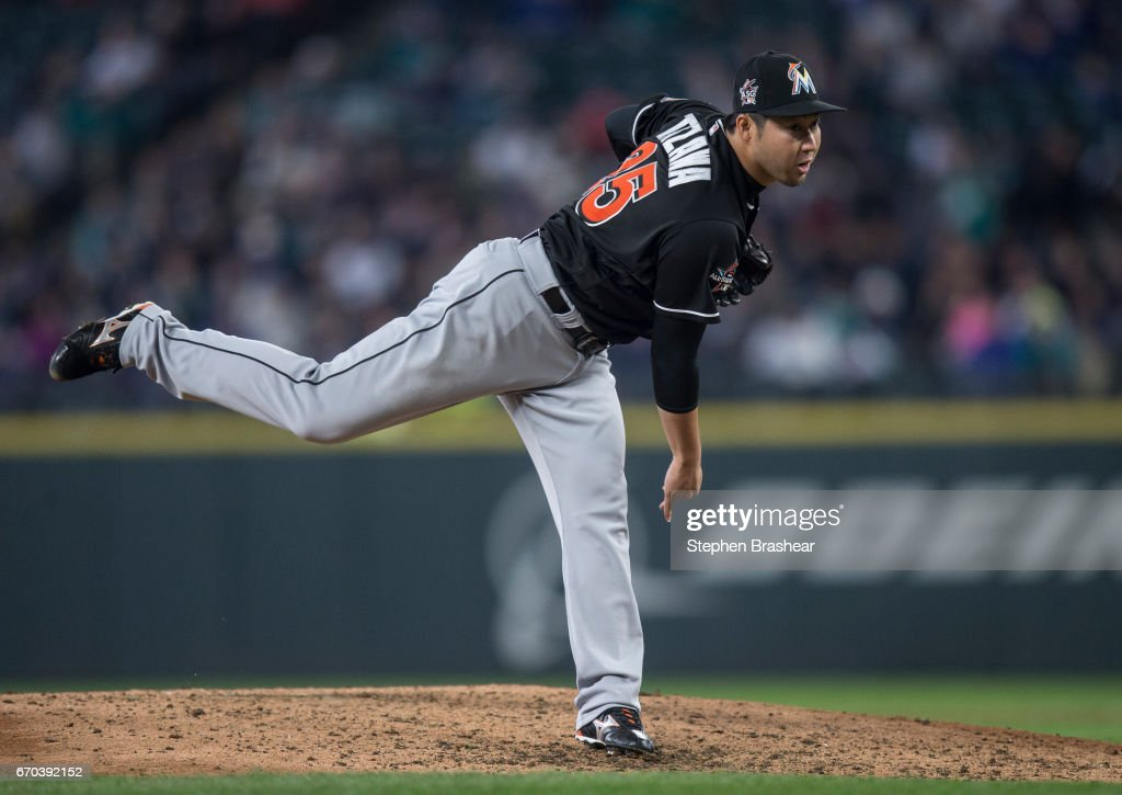 Reliever Junichi Tazawa #25 of the Miami Marlins delivers a pitch during the sixth inning of a game a game against the Seattle Mariners at Safeco Field on April 19, 2017 in Seattle, Washington. The Mariners won the game 10-5.