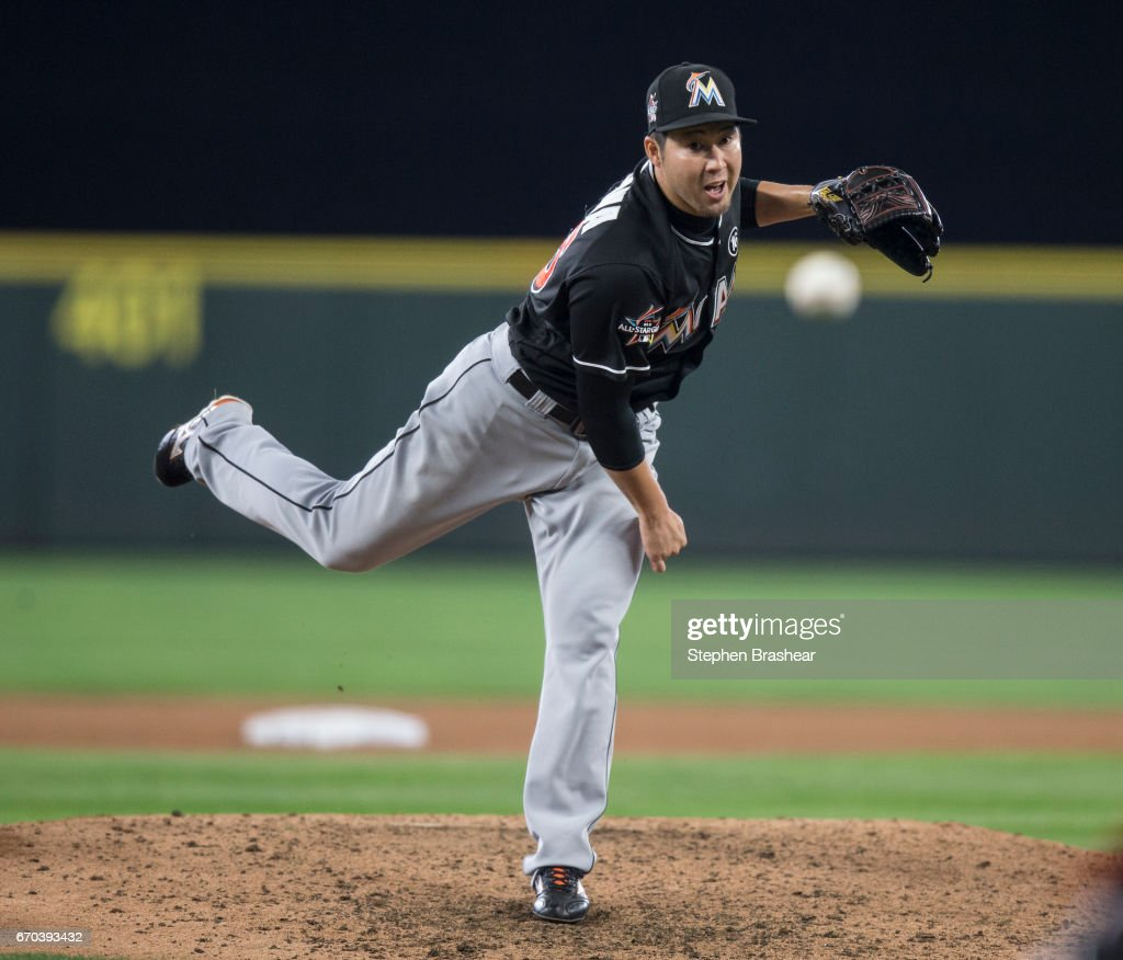 Reliever Junichi Tazawa #25 of the Miami Marlins delivers a pitch during the seventh inning of a game against the Seattle Mariners at Safeco Field on April 19, 2017 in Seattle, Washington. The Mariners won 10-5.