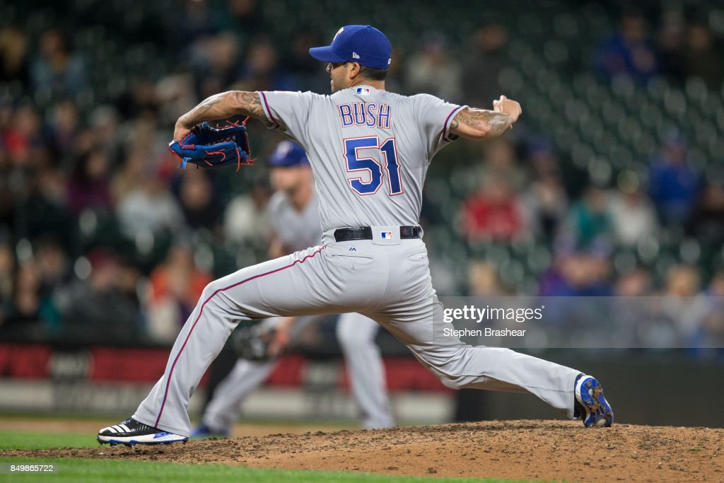 Reliever Matt Bush #51 of the Texas Rangers delivers a pitch during the eighth inning of a game against the Seattle Mariners at Safeco Field on September 19, 2017 in Seattle, Washington. The Rangers won the game 3-1.